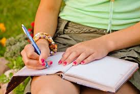 Writing in notebook